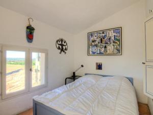 Кровать или кровати в номере Holiday Home L'Oustaou dei Figo