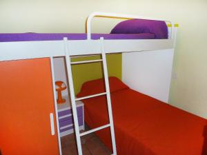 A bunk bed or bunk beds in a room at Apartment Perla II