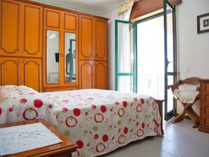 A bed or beds in a room at Locazione turistica Sunrise.1