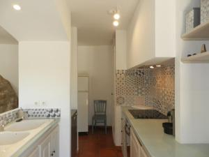 A kitchen or kitchenette at Holiday Home Domaine du Dragon.4