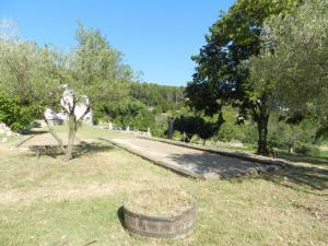 A garden outside Holiday Home Domaine du Dragon.4