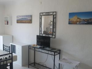 A television and/or entertainment center at Apartment KARUKERA