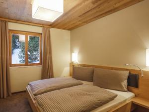 Ein Bett oder Betten in einem Zimmer der Unterkunft Apartment PRIVÀ Alpine Lodge SUP3