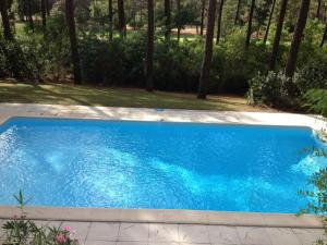 The swimming pool at or near Holiday Home Eden Parc
