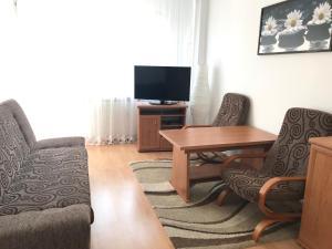 Een zitgedeelte bij Grochowska Apartament