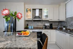 A kitchen or kitchenette at Ballito Luxury Family Apartment (on the beach)
