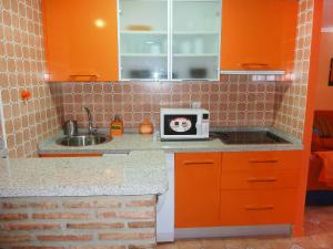 A kitchen or kitchenette at Apartment Perla II