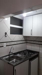 A kitchen or kitchenette at Minha Casa em Curitiba