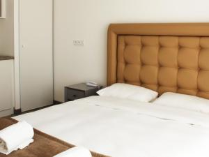 A bed or beds in a room at Apartment Adonis Aix en Provence.2