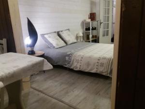 Postelja oz. postelje v sobi nastanitve Les Genets