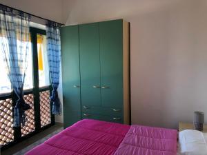 Een bed of bedden in een kamer bij Residence Verdemare