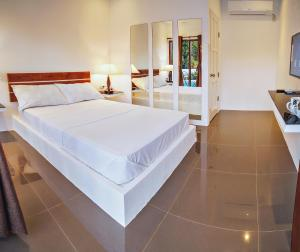 A bed or beds in a room at Quest Villa