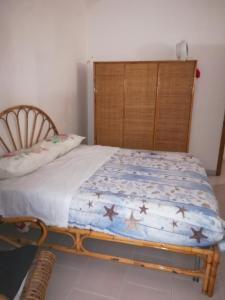 A bed or beds in a room at La Maddalena