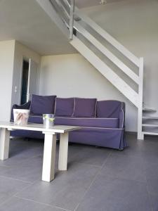 Een zitgedeelte bij Thea Houses