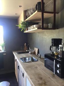 A kitchen or kitchenette at Côté Campagne