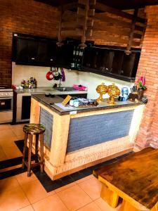 Cuisine ou kitchenette dans l'établissement Oceaner Villa