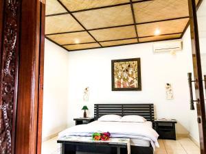 Un ou plusieurs lits dans un hébergement de l'établissement Oceaner Villa