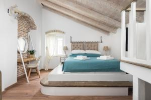 A bed or beds in a room at Corfu Sky Loft