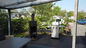 Barbecuefaciliteiten beschikbaar voor gasten van het chalet