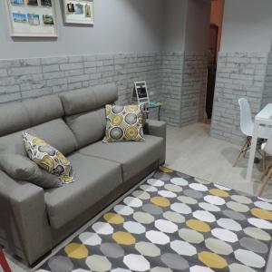 Coin salon dans l'établissement Apartamento Maribel