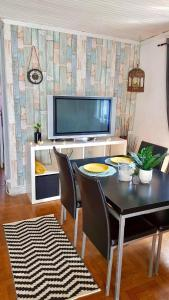 A television and/or entertainment center at Casa Urgueira