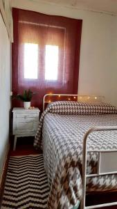 A bed or beds in a room at Casa Urgueira