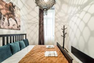 Letto o letti in una camera di Urban Stable Luxury Apartments