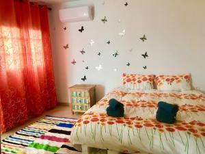 Ein Bett oder Betten in einem Zimmer der Unterkunft Finca Arcoiris