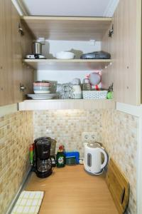 A kitchen or kitchenette at Astronomy Studios