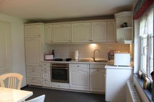 Küche/Küchenzeile in der Unterkunft Ferienwohnung Haus Stein