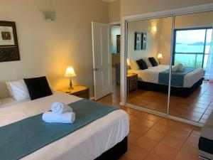 A bed or beds in a room at Compass Point 2