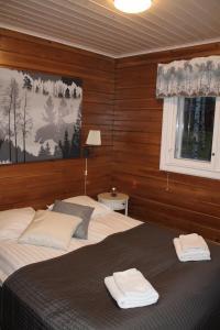 Vuode tai vuoteita majoituspaikassa Loma-Vietonen Holiday Village