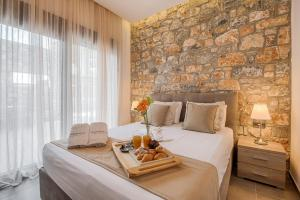A bed or beds in a room at Prasonisi Villas