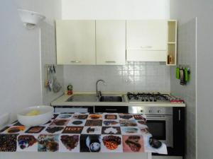 A kitchen or kitchenette at Apartment Porto Cervo