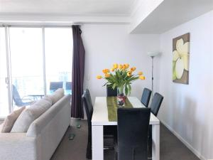 A seating area at Beach Stay - Ocean & Riverview resort Chevron Renaissance central Surfers Paradise