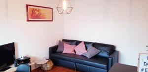 Ein Sitzbereich in der Unterkunft Chez Damien