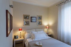 A bed or beds in a room at Appartamento con Vista in XXV Aprile