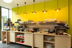 A restaurant or other place to eat at Aparthotel Adagio Access Paris Reuilly