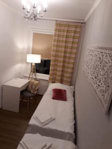Łóżko lub łóżka w pokoju w obiekcie Apartament Joanna II