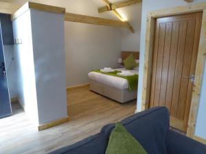 A bed or beds in a room at Auchendennan Luxury Self Catering Cottages
