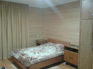 Кровать или кровати в номере House at Krasnaya Polyana