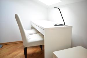 A kitchen or kitchenette at Bright apartment 1 in the heart of Prague