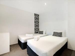 A bed or beds in a room at Iconic 5 Star Luxury in the Q Surfers Paradise