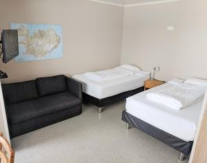 A bed or beds in a room at Studio GuestHouse Seyðisfirði