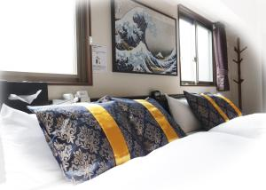 A bed or beds in a room at Asakusa Eight -Tokyo Condominium Hotel-