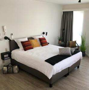 Ein Bett oder Betten in einem Zimmer der Unterkunft CITYSTAY