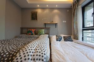 Ein Bett oder Betten in einem Zimmer der Unterkunft Shanghai City Life Service Apartment