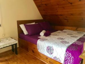A bed or beds in a room at Apartment Dunavski Biser
