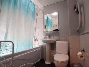 Ванная комната в Апартаменты Добрый Дом