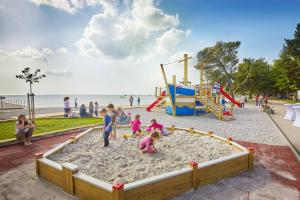 Children's play area at Adria Apartments - Hotel & Resort Adria Ankaran